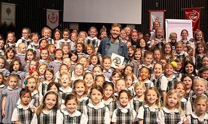 author mac barnett with ASH Lower School students